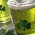 Close up of beverages with shamrocks on glass